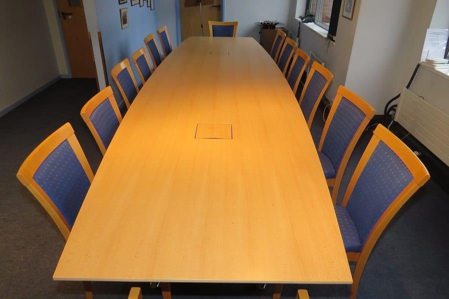 Flip-top meeting table in veneer