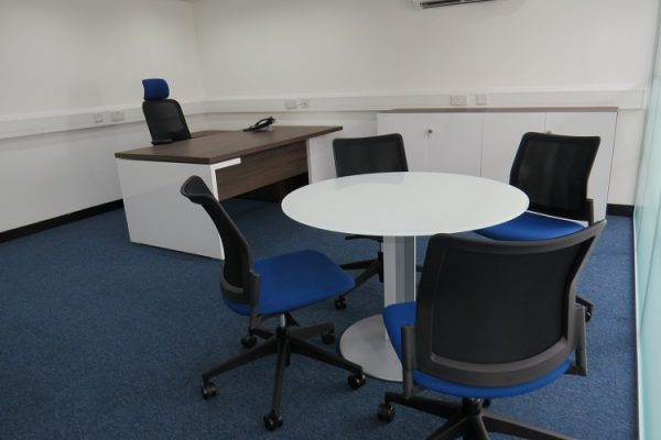 managers desk with round meeting table