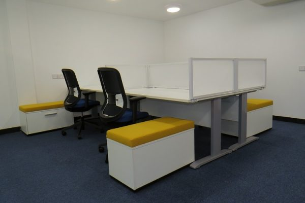 office desks with screens and pedestal seats